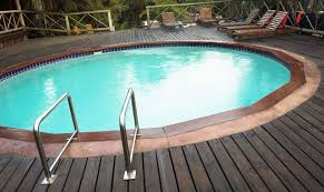 above ground pool with deck surround. This Above Ground Swimming Pool Has Wooden Decking That Surrounds The Entire Structure. Simple Touch Of Using Bamboo Style Railings Helps Make With Deck Surround