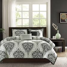 bedroom black and white comforter sets queen bedspreads stained wooden bed full green table lamp