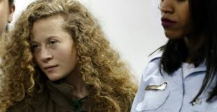 afp file palestinian ager ahed tamimi c appears in december at a military court at the israeli run ofer prison in the west bank village of betunia