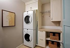 stackable washing machine. Simple Laundry Room Design With Dull White Cabinetry And Recessed Smalles Stackable Washer Dryer Washing Machine