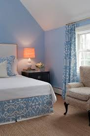 white curtains with light blue walls in bedroom