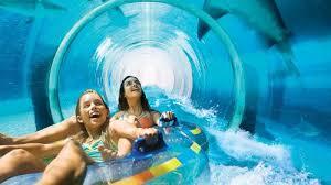 underwater water park. Show Item 2 Of 5. Two Girls Sliding Down Underwater Slide In Dubai Water Park