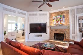 corner tv armoire family room transitional with brick fireplace surround ceiling