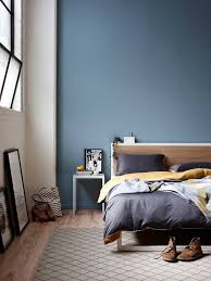Awesome A Captivating Blue Hue Sets A Fearless Backdrop For This Dreamy Bedroom,  Accentuated By The Two Toned Paint Scheme, Natural Wood Flooring, And  Streamlined ...