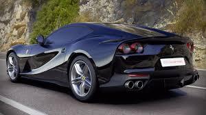 Seen in silhouette, the 812 superfast has a fastback sleekness: 2018 Ferrari 812 Superfast Black Wallpaper