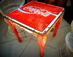 i love this old mexican coca cola table it looks like a marriage between