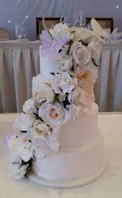 4 Tier Wedding Cake With Cascading Flowers And Butterflies Picture