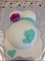 Pregnant Belly Cake For Baby Showercake Is Covered In Buttercream Belly Cake For Baby Shower