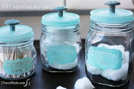 make stylish diy apothecary jars with glass paint and drawer knobs