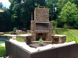 back to fun outdoor fireplace with tv above