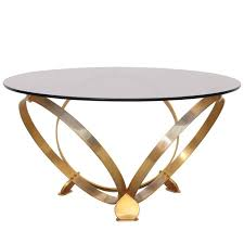 round brass geometric rings coffee table with glass top for