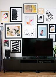 gallery wall created with bold black and brown frames and some frameless pictures living on wall art gallery ideas with interesting and elegant multicolored raindrops on the wall best