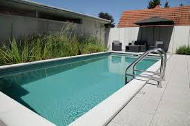 Bio Pool in Switzerland with solar heating on the carport