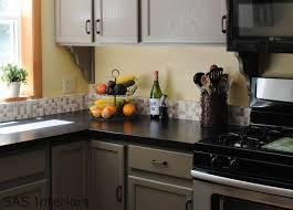 grey kitchen cabinets with black granite countertops trekkerboy