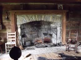 bearskin rug hearth cooking equipment and print of crockett on mantle
