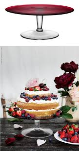 DIY Wedding - A homemade cake layered with cream and berries, set atop a  mouth-blown glass Ikea AKTAD cake stand and decorated with fresh flowers is  simply ...