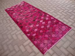 image of pink color overdyed vintage rugs