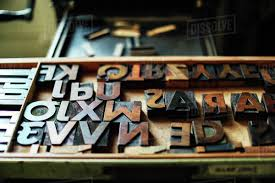 tray of wooden letterpress letters in book arts work