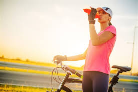 image drinking energy drink after training