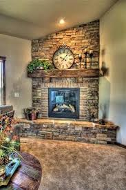 Stone and brick fireplace. This would look awesome in the corner of the  living room