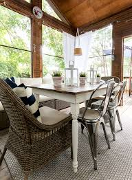 navy white screen porch it all started with paint farmhouse table wicker and metal chairs screen porch