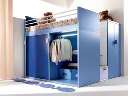 small bedroom decorating tips using blue wooden loft bed with closet and fish shaped rug