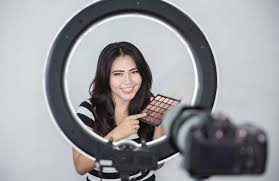 beauty vlogger using ring light for you videos