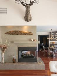example of a trendy living room design in los angeles with a two sided fireplace