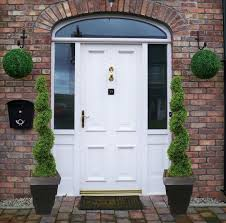 topiary trees outdoor for eccentric brick house design topiary trees outdoor with white wooden front