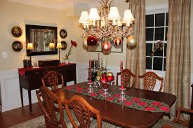 flashing bright classic chandelier with christmas ball above simple floral red centerpiece on wooden rectangle table beautiful funky dining room lights