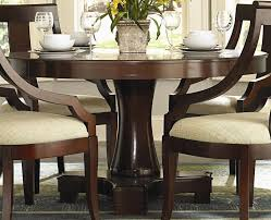 cherry finish round pedestal dining table by coaster furniture 101181 dallas fort worth