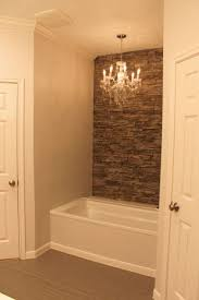 Accent Wall Bathroom My Tub With Faux Stone Wall Accent Wall And Chandelier Bathroom