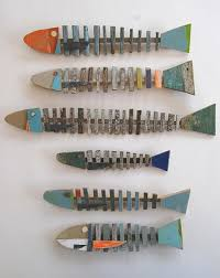 wood slat fish hangings on painted wood fish wall art with 7 wooden fish wall decor ideas for your beach house beach bliss living