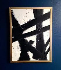 black and white wall art with gold frame