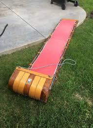 vintage wooden toboggan sled