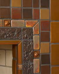 fireplace tile surround installation by pewabic