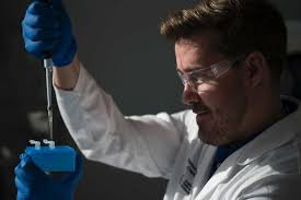 a scientist dr testing his do it yourself kit to detect diseases