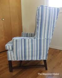a slipcover makeover for an old wing back in blue woven stripe canvas canvas awnings