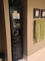winsome wood alps tall cabinet with glass door black finish com