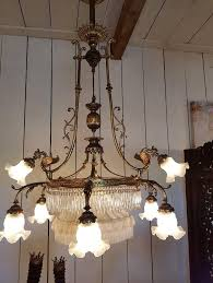 french chandelier with nine lights and in the center a pulley system so you can