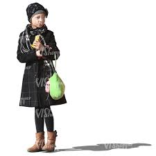 young girl in a winter coat standing and eating a snack