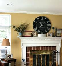 living room mantel decorating ideas restrained gold paint color red brick fireplace country farmhouse style mantel decor living room decor tips