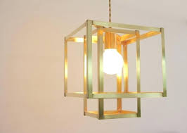 image 0 gold light pendant cage canada brass mid century modern