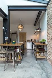 exposed steel structure residential renovation rustic kitchen concrete floor
