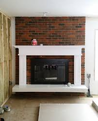 brilliant mantel black paint was perfect for this old outdated fireplace makeover to white fireplace mantel with red brick c