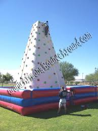 this inflatable 4 person rock wall al is 26 feet tall perfect for events and easier to climb than a hard rock wall allows high volume of rock climbers
