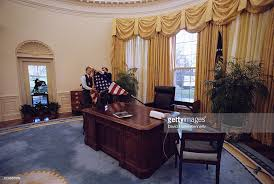clinton oval office. White House Staff Change The Furnishings Of Oval Office While Newly Elected Bill Clinton Is