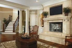 this incredible fireplace is full and luxurious the television mounted above it does not take