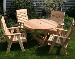 small round outdoor wooden picnic table with umbrella hole and 4 chairs with arms and back ideas