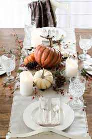 This simple and neutral fall tablescape is exactly how I want to decorate  my Thanksgiving table